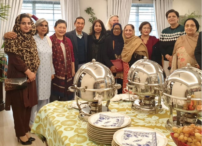 Spouse of the high commissioner of Brunei poses with members of the Asian Study Group in Islamabad.