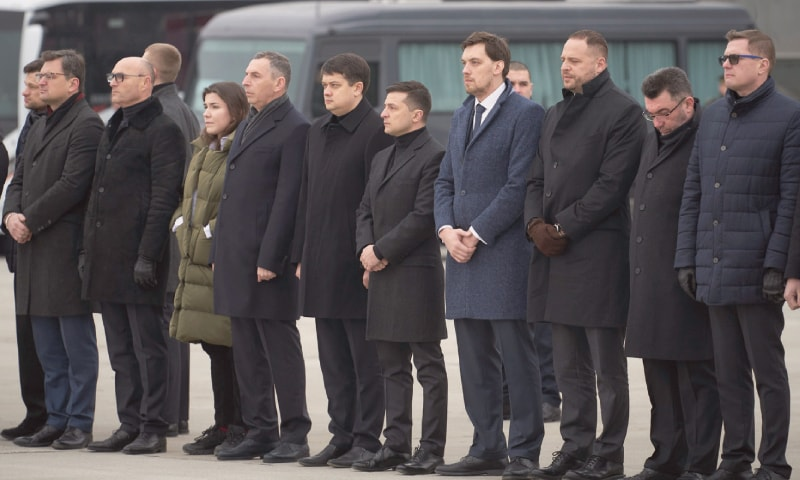 Ukrainian President Volodymyr Zelenskiy (centre) and Prime Minister Oleksiy Honcharuk (centre right) seen before a memorial ceremony for the crash victims at the Borispil international airport outside Kiev on Sunday.—AP