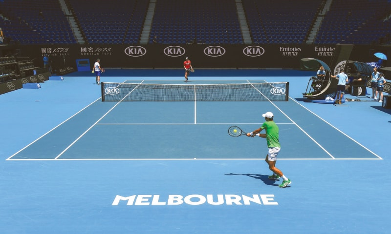 MELBOURNE: Novak Djokovic of Serbia hits a return during a practice session for the Australian Open on Sunday.—AFP
