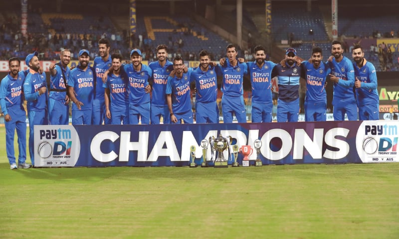 BENGALURU: Members of Indian team pose with the trophy after the third One-day International against Australia on Sunday.—AP