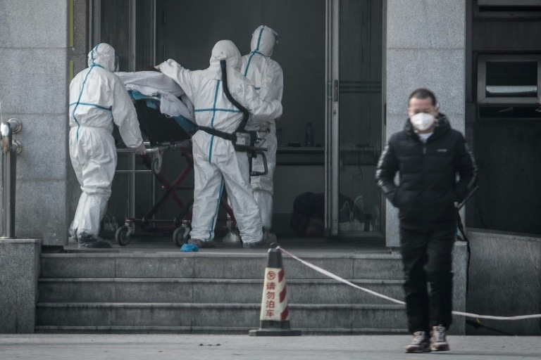 China confirms human-to-human transmission as SARS-like virus spreads