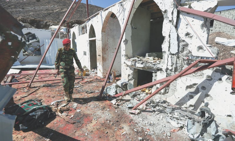 MARIB (Yemen): A soldier walks at the site of the Houthi missile attack on a military camp mosque.—Reuters