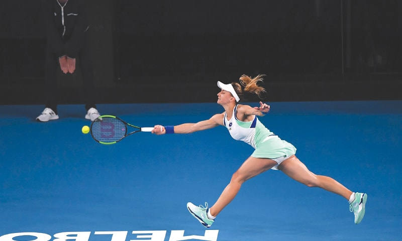 UKRAINE'S Lesya Tsurenko stretches for a return against Ashleigh Barty of Australia during their first-round match at the Australian Open on Monday.—AFP