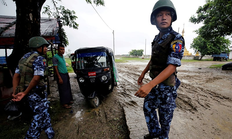 Myanmar police officer stands guard in Maungdaw, Rakhine on July 9, 2019. — Reuters/File