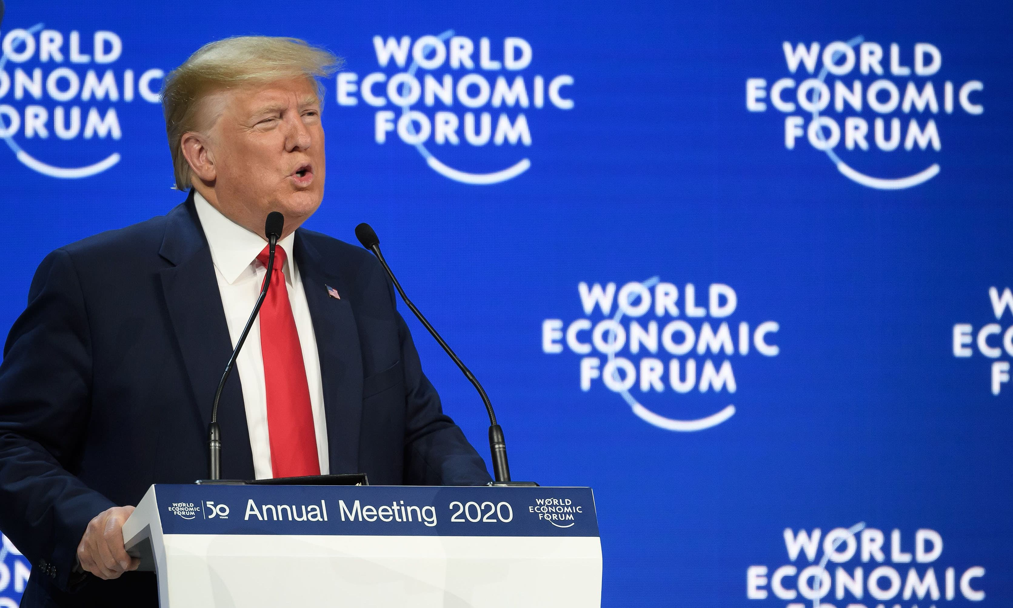 Trump rejects climate 'prophets of doom' as Thunberg warns Davos