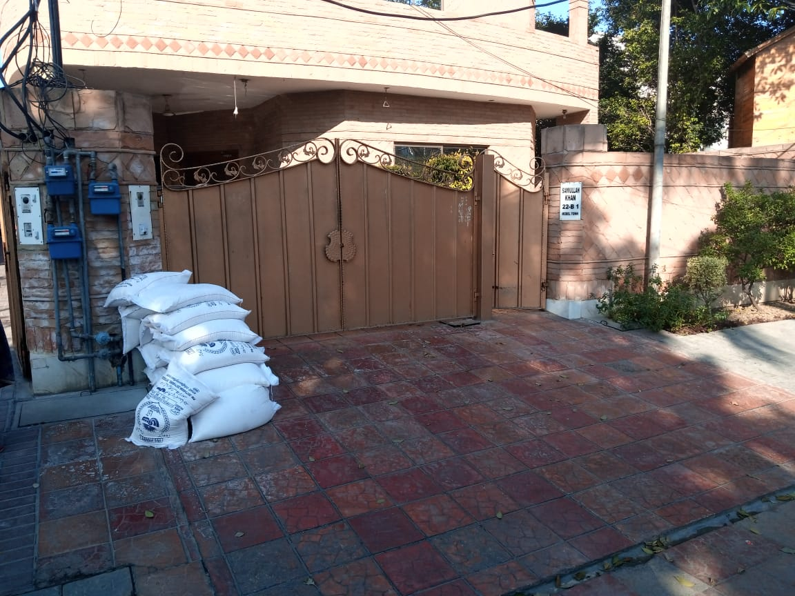 Wheat bags piled outside Bukhari's house. — Photo provided by author