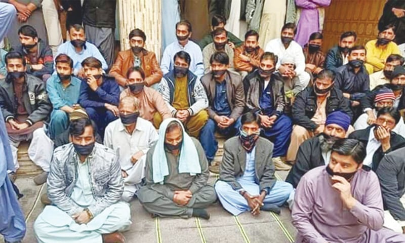 MEMBERS of Hindu community hold a demonstration in Jacobabad on Wednesday.—Dawn