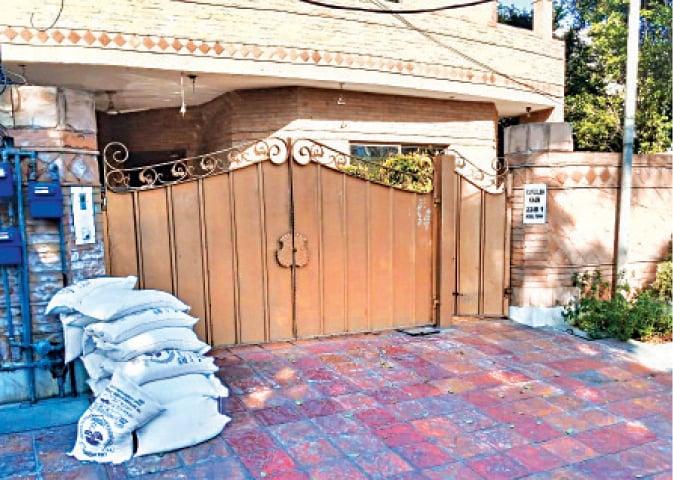 PFA dumps flour bags outside Azma's house