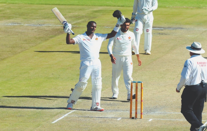 HARARE: Sri Lankan batsman Angelo Mathews celebrates after completing his double century during the first Test against Zimbabwe at the Harare Sports Club on Wednesday.—AP