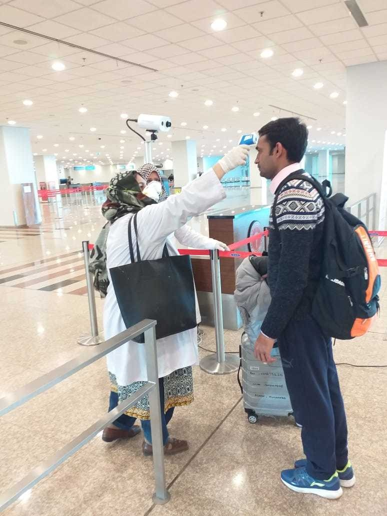 Health officials check a passenger arriving at a Pakistan airport for fever. — Photo provided by Haseeb Bhatti