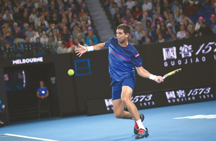 MELBOURNE: Argentina's Federico Delbonis hits a return to Rafael Nadal of Spain during their match at the Australian Open on Thursday.—AFP