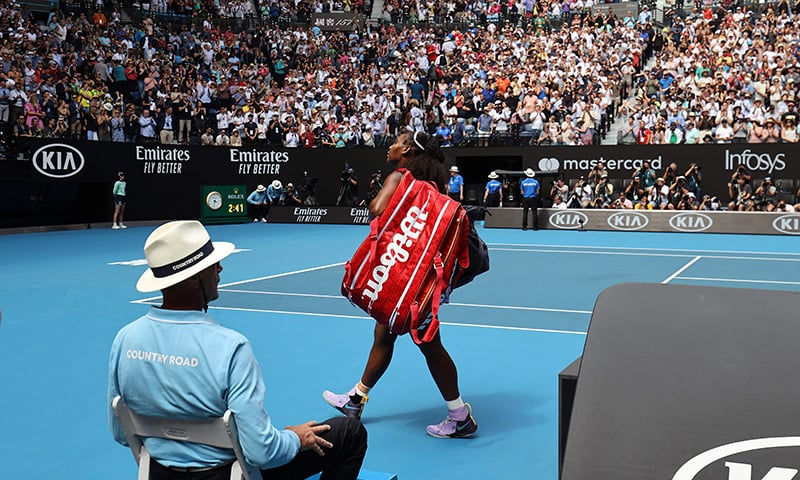 Serena Williams walks off the court after losing to China's Wang Qiang in their women's singles match on day five of the Australian Open on Jan 24. — AFP