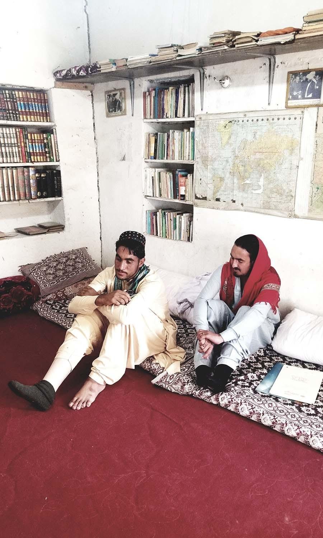 Kabeerullah and Wazir Alam inside Al-Hassan Library, Kotkai.