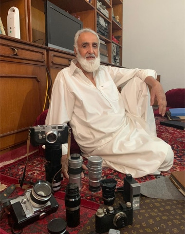 Mir Ahmed Shah showing his collection of manual cameras