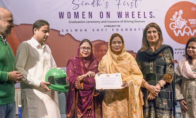PPP lawmaker Faryal Talpur gives a certificate to a participant of the programme on Friday.—White Star