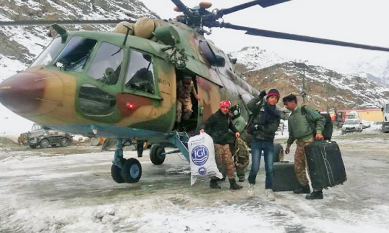 An army chopper drops passengers in Skardu on Friday. —Dawn