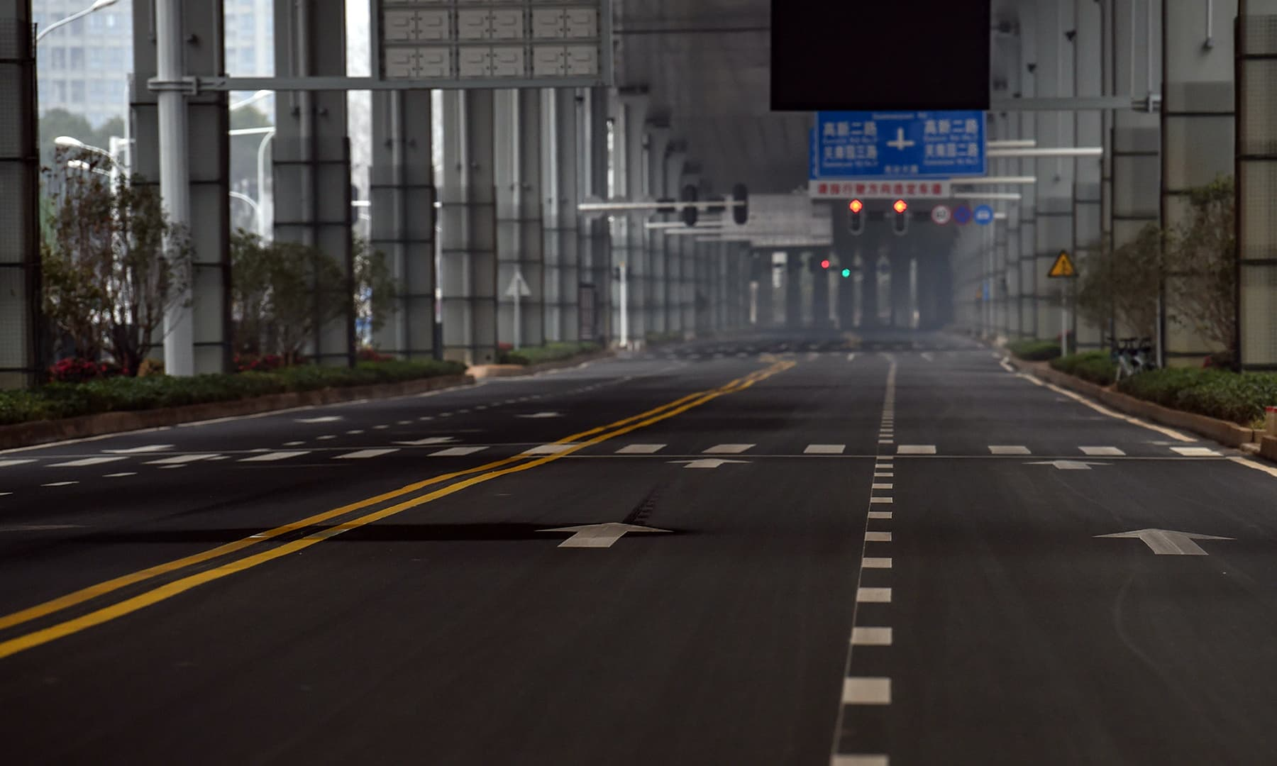 An empty road is seen on the first day of the Lunar New Year in Wuhan in China's central Hubei province on January 25, 2020, during a deadly virus outbreak which began in the city. — AFP