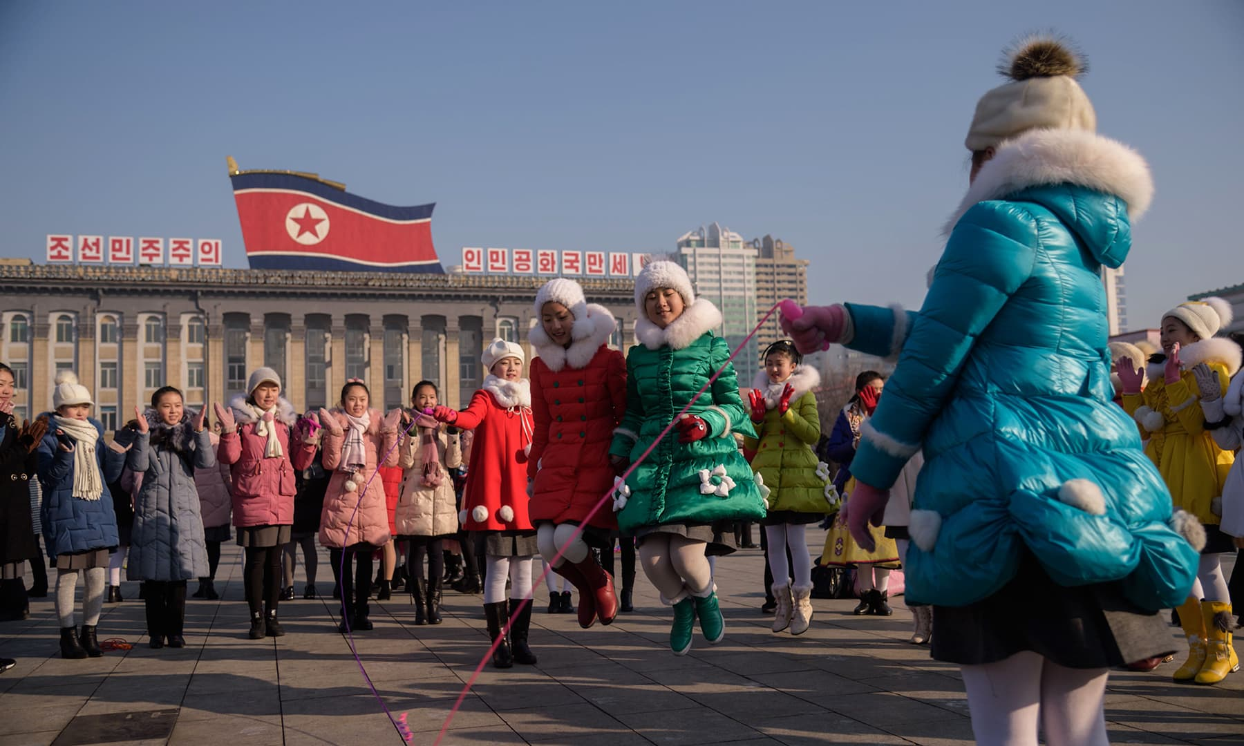 Children play with a skipping rope on Kim Il Sung Square as part of festivities on the first day of the Lunar New Year in Pyongyang, North Korea on January 25, 2020. — AFP