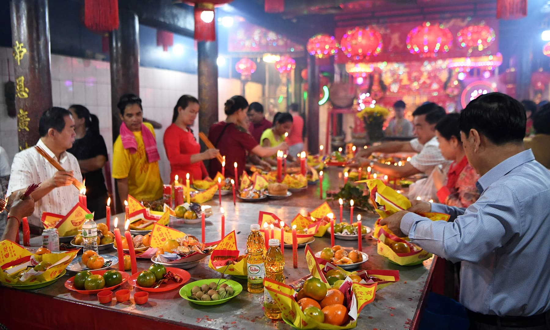 People pray during the Lunar New Year at a temple in Kandal Province, Cambodia on January 25, 2020. — AFP