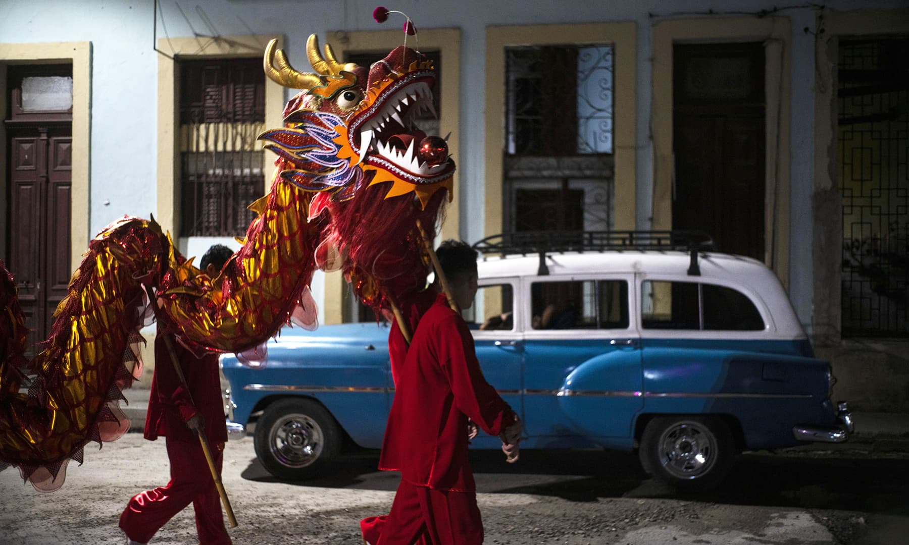 Dancers from the Cuban Wushu Association return home after performing during the ceremony to welcome the Chinese New Year in Havana, Cuba on January 24, 2020. — AP