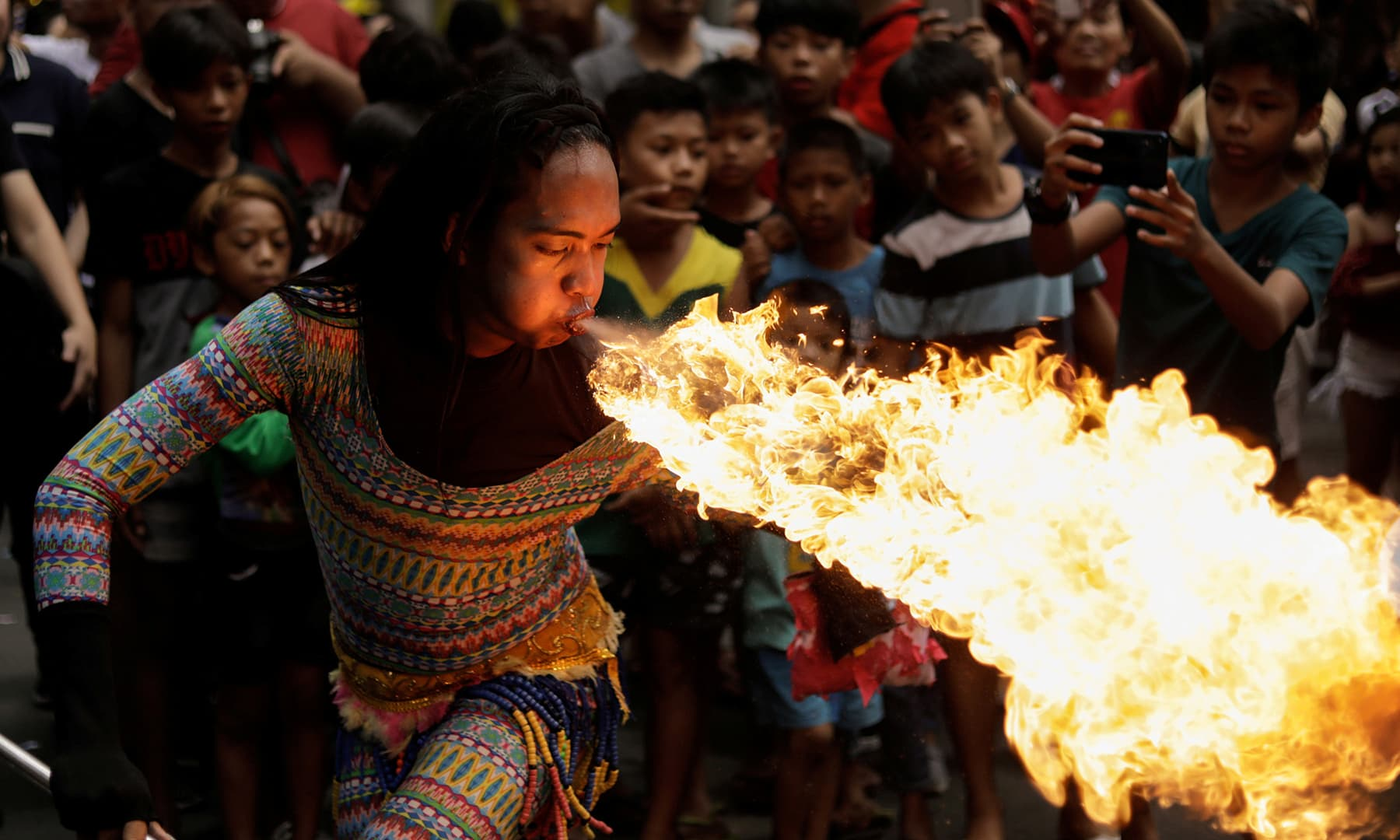 A performer blows fire during Chinese Lunar New Year celebrations in Chinatown, Binondo, Manila, Philippines on January 25, 2020. — Reuters