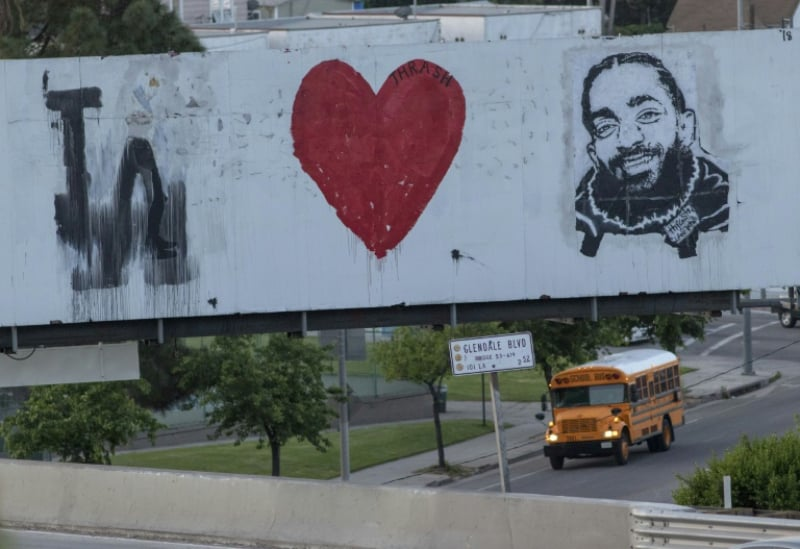 AFP/File / Kyle Grillot... A mural along US Highway 101 honors slain rapper Nipsey Hussle, who is posthumously up for three Grammys