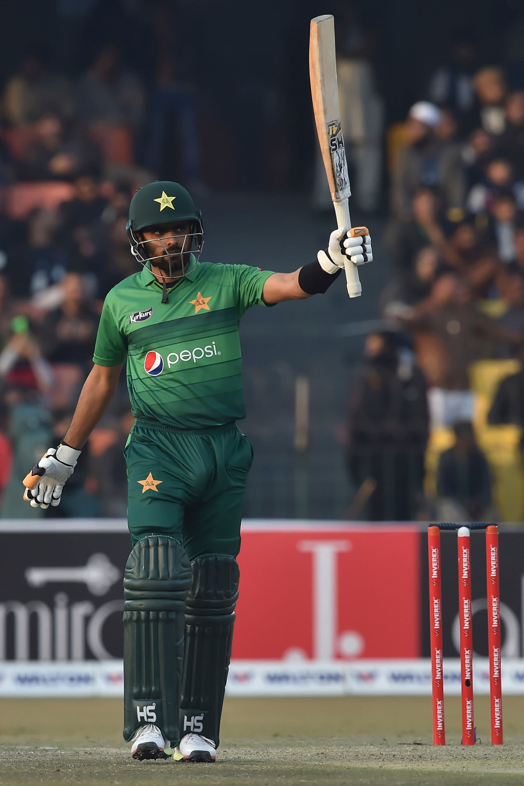 Pakistan captain Babar Azam celebrates scoring a half century (50 runs) at the Gaddafi Cricket Stadium in Lahore on Saturday. — AFP