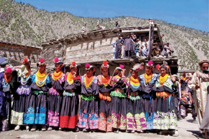 Kalash women dance during a festival in Bumburate valley. — Dawn