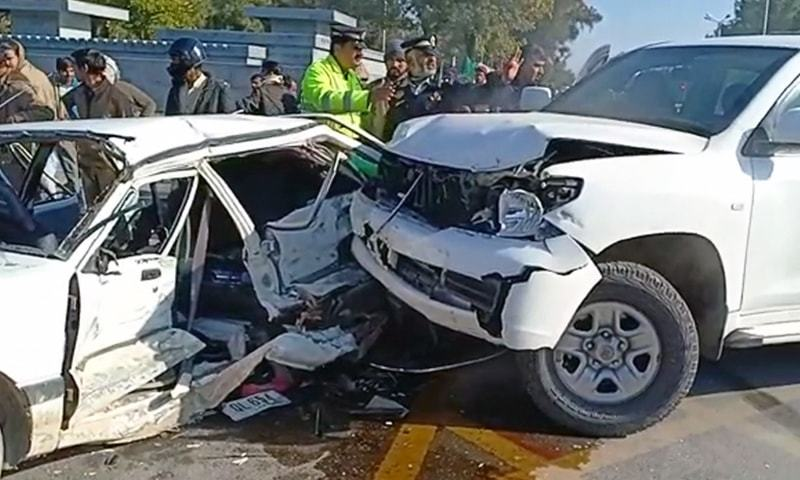 A view of the aftermath of the collision between the US embassy vehicle (R) and a car. — DawnNewsTV