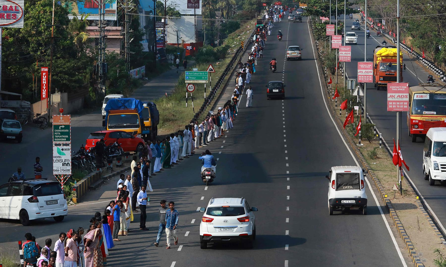 People line up along a road to form a 620km human chain across the southern state of Kerala organised by the Left Democratic Front (LDF) to protest against the Indian government's Citizenship Amendment Act in Kochi. — AFP