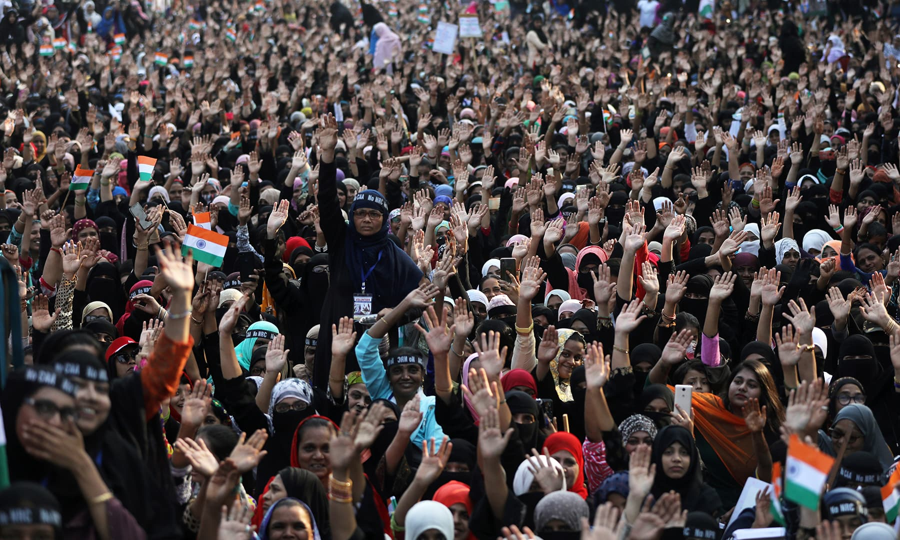 Demonstrators gesture during a protest against a new citizenship law on the outskirts of Mumbai, India, January 26. — Reuters
