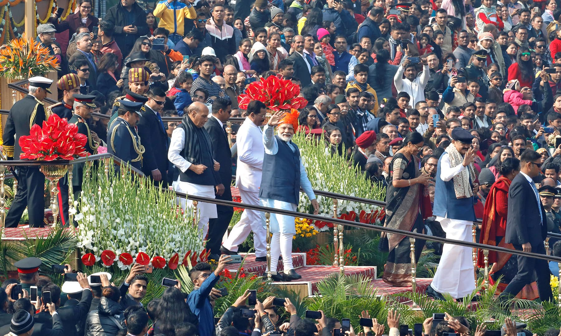India's Prime Minister Narendra Modi waves to the crowd after attending Republic Day parade in New Delhi. — Reuters