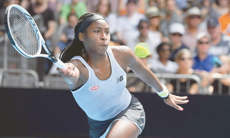MELBOURNE: Coco Gauff hits a return to fellow American Sofia Kenin during their fourth-round match at the Australian Open on Sunday.—AFP
