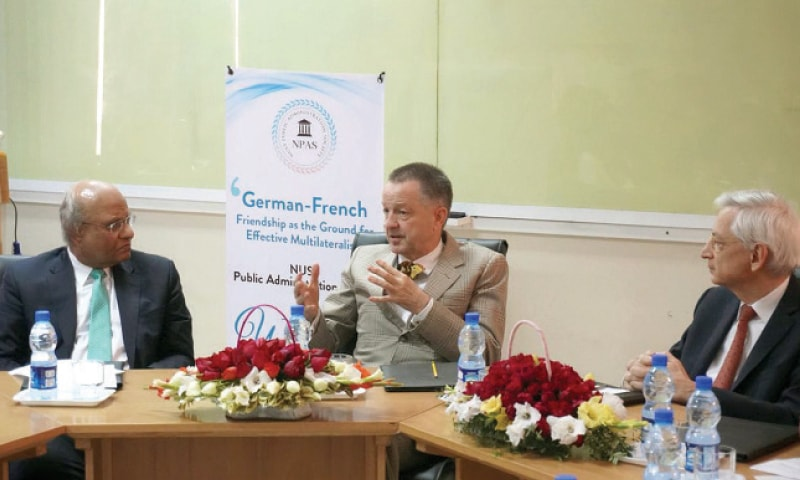 German Ambassador Bernhard Schlagheck speaks during the lecture at Nust. French envoy Marc Baréty is also seen.
