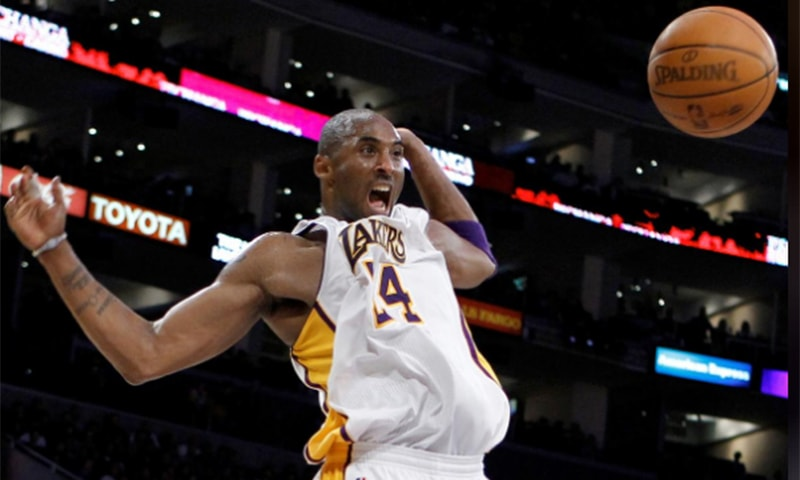 In this file photo Kobe Bryant of the Los Angeles Lakers celebrates after dunking against the New York Knicks during their NBA basketball game in 2011. — Reuters