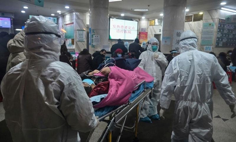 یہ وائرس سب سے پہلے چین کے شہر ووہان میں دسمبر 2019ء میں پھیلنا شروع ہوا تھا — فوٹو: اے ایف پی