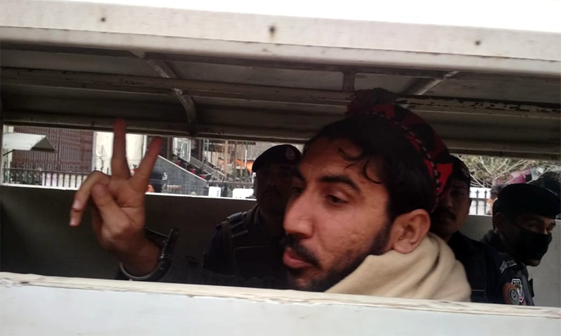 PTM chief Manzoor Pashteen gestures as police shift him from Peshawar's Judicial Complex. — Photo provided by Sirajuddin