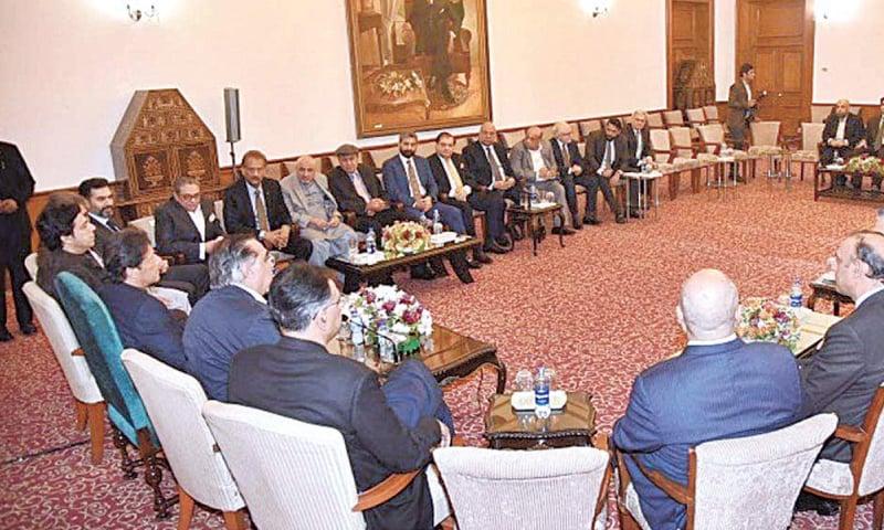 A DELEGATION of businessmen from Karachi calls on Prime Minister Imran Khan on Monday.—APP