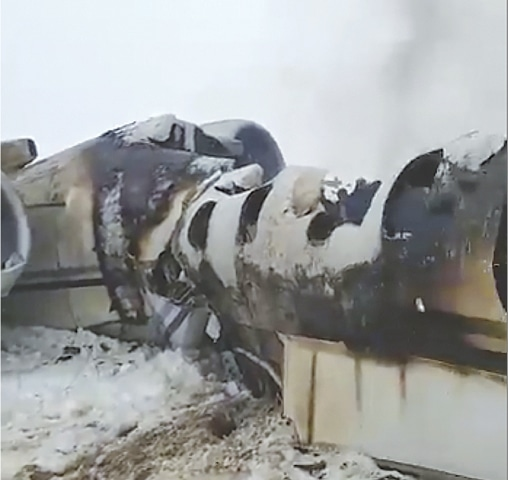 THIS photo provided by a local journalist shows an aircraft that crashed in eastern Afghanistan on Monday.—AP