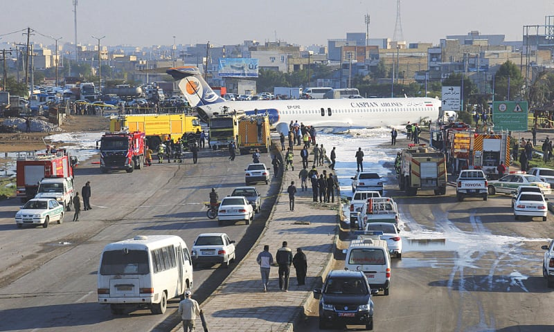 AN Iranian passenger plane sits on a road outside Mahshahr airport after skidding off the runway on Monday.—AP