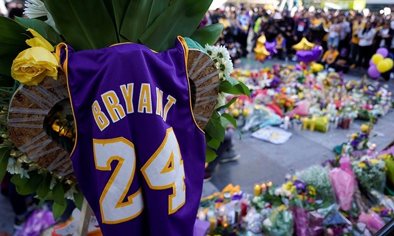 Fans of NBA basketball star Kobe Bryant pay their respects at a memorial outside the Staples Center at LA Live in Los Angeles, California, US, on January 27. — Reuters