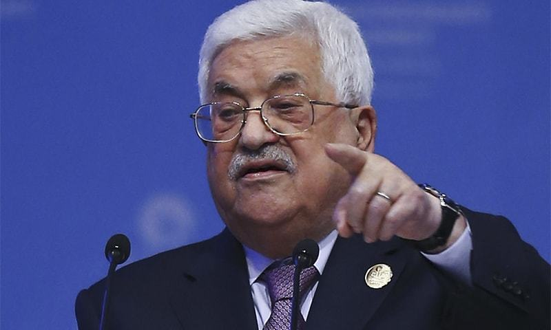 """Palestinian President Mahmoud Abbas addresses the Organisation of Islamic Cooperation's Extraordinary Summit in Istanbul, Wednesday, Dec. 13, 2017. Abbas said the Palestinians won't accept any role for the United States in a peace process with Israel """"from now on"""" after the U.S President Donald Trump administration's decision to recognise Jerusalem as the capital of the Jewish state. Abbas said Trump's decision was a """"crime"""" that threatens world peace. (Emrah Yorulmaz/Pool Photo via AP)"""