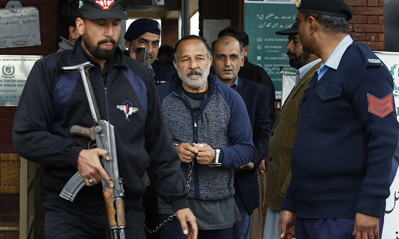 Police officers escort Piran Ditta Khan, centre, who was arrested in the killing of a British woman police officer, following his court appearance in Islamabad on Wednesday. — AP
