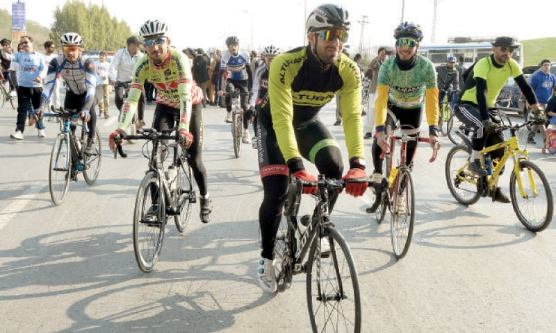 People participate in a bicycle rally in Islamabad on Friday. — White Star