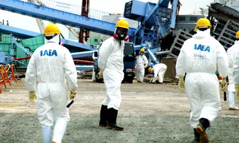 In this May 27, 2011 photo released by the International Atomic Energy Agency, or IAEA, members of the IAEA fact-finding team in Japan visit the Fukushima Dai-ichi nuclear plant in Okuma, Fukushima prefecture, northern Japan. — AP/File