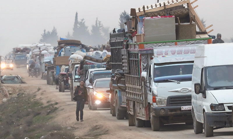 A view of trucks carrying belongings of displaced Syrians is pictured in the town of Sarmada in Idlib province.—Reuters