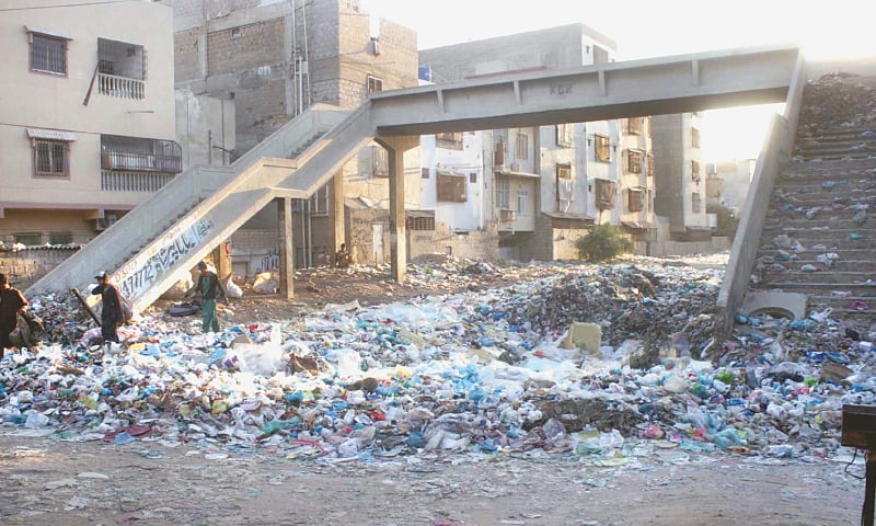 WHILE the railway minister has claimed to have cleared 38 kilometres of Karachi Circular Railway tracks, garbage piles seen at the KCR's defunct Nazimabad station on Sunday.—Online