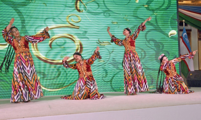 Uzbek dancers perform during the Armed Forces Day celebrations of their country in Islamabad.