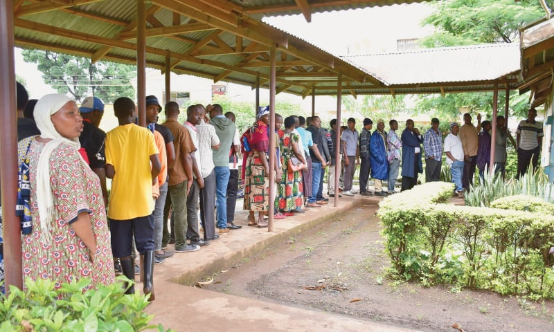 DAR ES SALAM: People queue outside a hospital in Tanzania's Kilimanjaro region on Sunday to identify their relatives who were caught in the stampede.—AFP