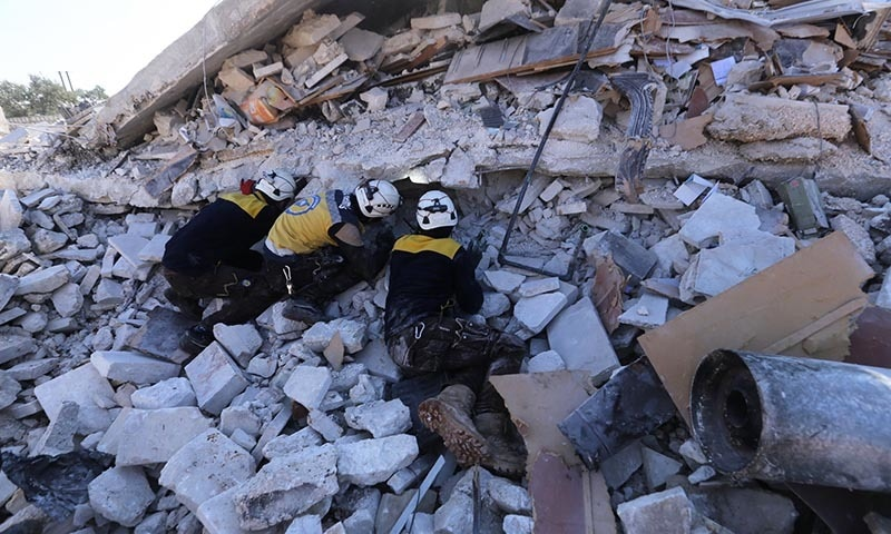 Syrian rescuers search for victims between rubble of a destroyed house after airstrikes at the northern town of Sarmin, in Idlib province, Syria, on Feb 2, 2020. — AP